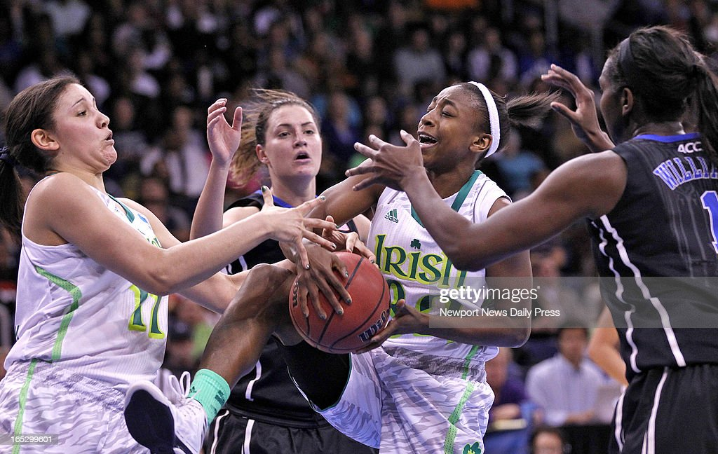 Notre Dame's Natalie Achonwa, left, and Jewell Loyd, center, battle for a rebound with Duke's Haley Peters and Elizabeth Williams, right, in an NCAA Tournament regional final at the Ted Constant Center in Norfolk, Virginia, on Tuesday, April 2, 2013.