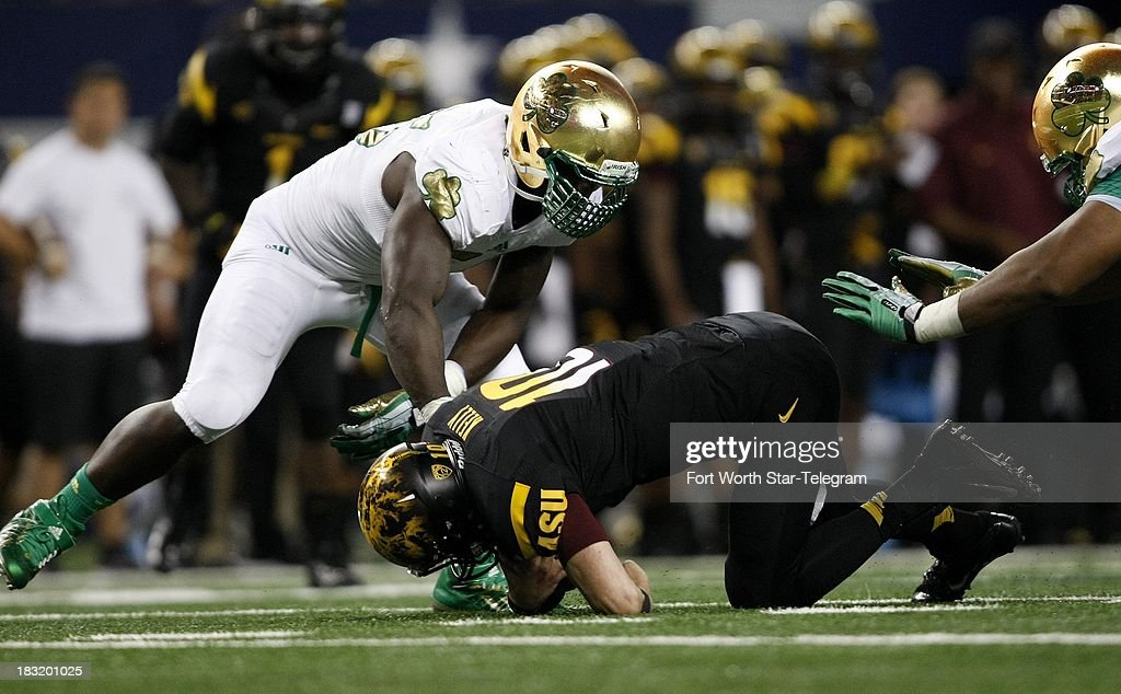 Notre Dame's Prince Shembo sacks Arizona State quarterback Taylor Kelly during the game at AT&T Stadium in Arlington, Texas, Saturday, October 5, 2013. Notre Dame beat ASU, 37-34.