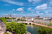 Notre-Dame cathedral in Paris in Spring. Panoramic aerial view of islands on the river Seine.