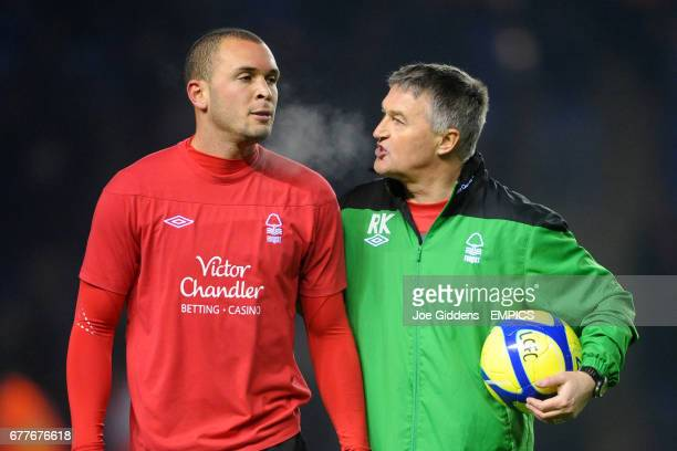 Nottingham Forest assistant manager Rob Kelly chats with Joel Lynch before the match