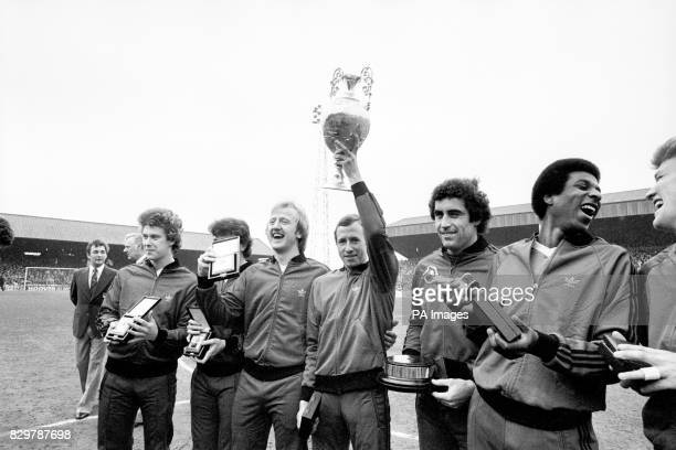 Nottingham Forest captain John McGovern holds the League Championship trophy aloft as his teammates celebrate with their medals Tony Woodcock John...
