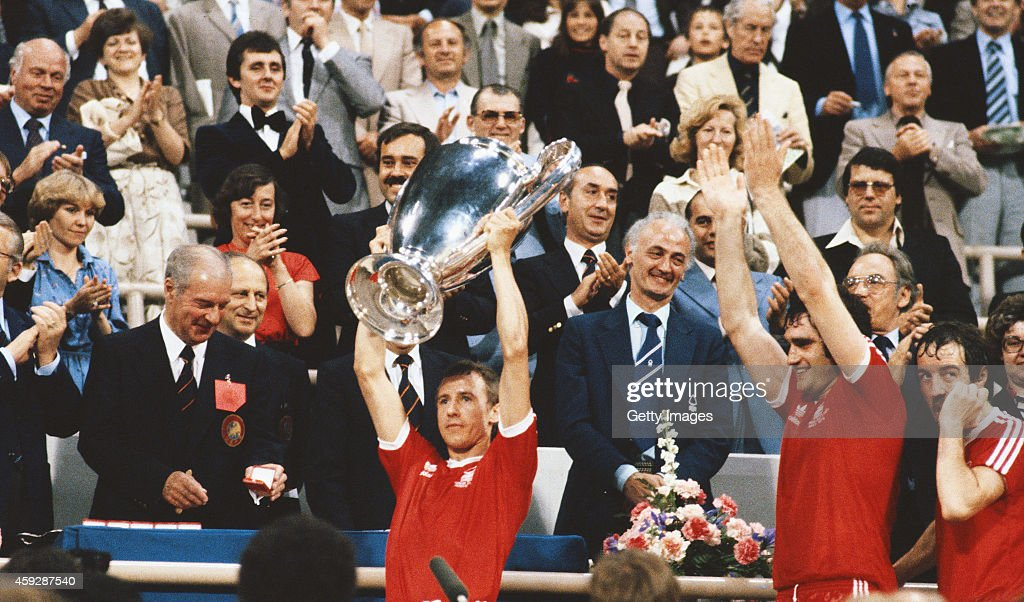Nottingham Forest captain John McGovern lifts the trophy as team mates Larry Lloyd and Frank Clark look on after the 1979 European Cup Final between...