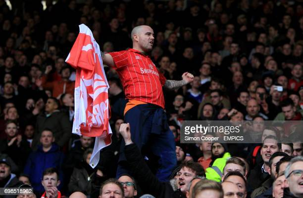 Nottingham Forest fans celebrate after Britt Assombalonga scores his sides first goal of the game