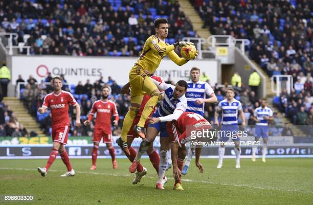 Nottingham Forest goalkeeper Karl Darlow claims the ball under pressure from Reading's Hal RobsonKanu