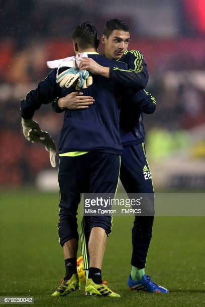 Nottingham Forest goalkeepers Dimitar Evtimov and Karl Darlow embrace before the game