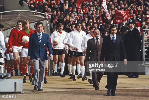 Nottingham Forest manager Brian Clough leads out his team Larry Lloyd and Chris Woods as Liverpool boss Bob Paisley does likewise before the start of...