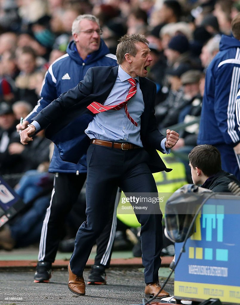 Nottingham Forest manager Stuart Pearce celebrates after their first goal during the Sky Bet Championship Match between Derby County and Nottingham Forest at iPro Stadium on January 17, 2015 in Derby, England.