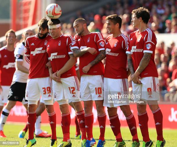 Nottingham Forest players Djamel Abdoun Jamie Mackie Henri Lansbury Chris Cohen and Darius Henderson during a free kick
