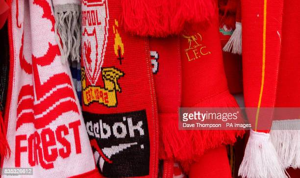 A Nottingham Forest scarf and Liverpool scarves hang on the Shankly Gates before the official memorial service at Liverpool's Anfield stadium to mark...