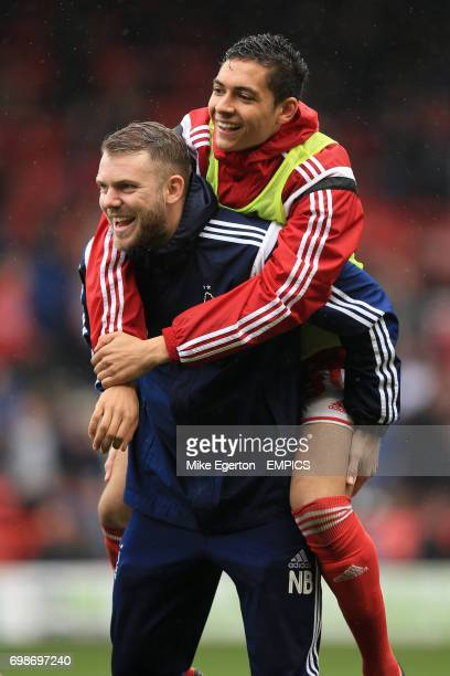 Nottingham Forest strength and conditioning coach Nathan Beardsley gives a piggy back to Tyler Walker