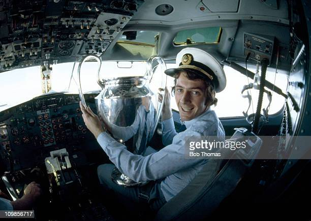 Nottingham Forest striker Trevor Francis with the European Cup in the cockpit of the aircraft bringing the team home from Munich after their 10...