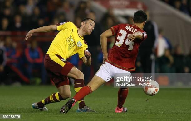 Nottingham Forest Tyler Walker and Burnley's David Jones battle for the ball