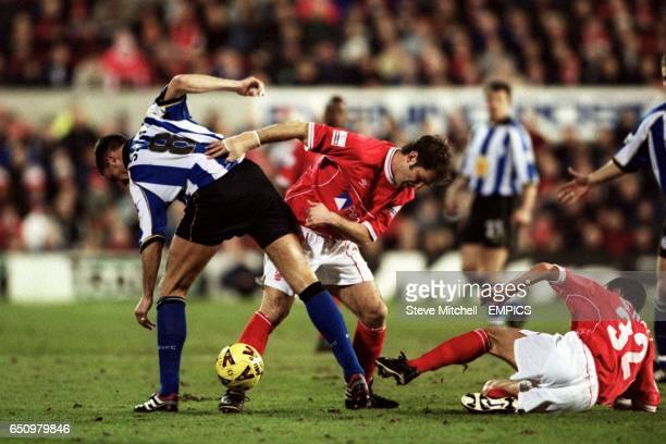 Nottingham Forest's Andy Johnson and Francis Benali battle with Sheffield Wednesday's Gerald Sibon