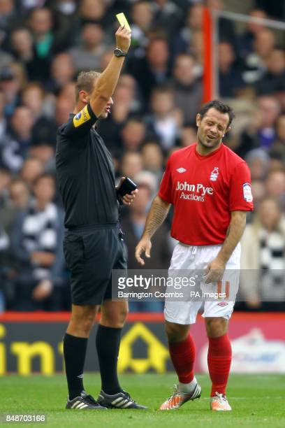 Nottingham Forest's Andy Reid reacts as he is issued a yellow card by referee Robert Madley