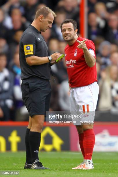 Nottingham Forest's Andy Reid speaks to referee Robert Madley
