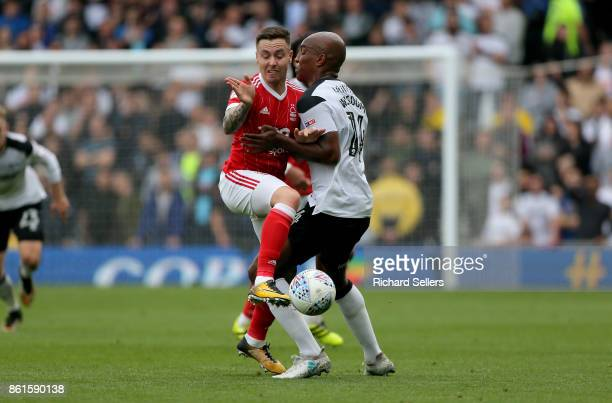 Nottingham Forest's Barrie McKay collides with Derby County's Andre Wisdom during the Sky Bet Championship match between Derby County and Nottingham...