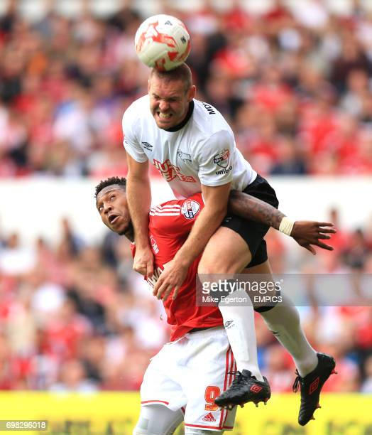 Nottingham Forest's Brit Assombalonga and Derby County's Jake Buxton