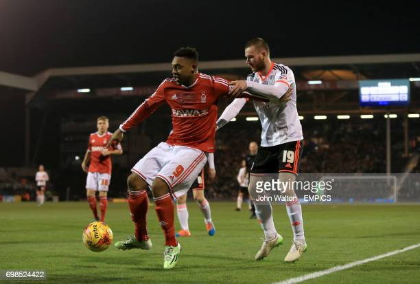 Nottingham Forest's Britt Assombalonga holds the ball up under pressure from Fulham's Ryan Tunnicliffe