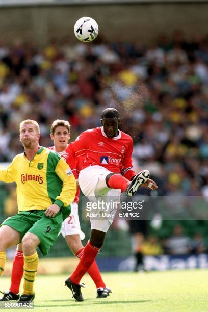 Nottingham Forest's Chris BartWilliams clears the ball from Norwich City's Iwan Roberts
