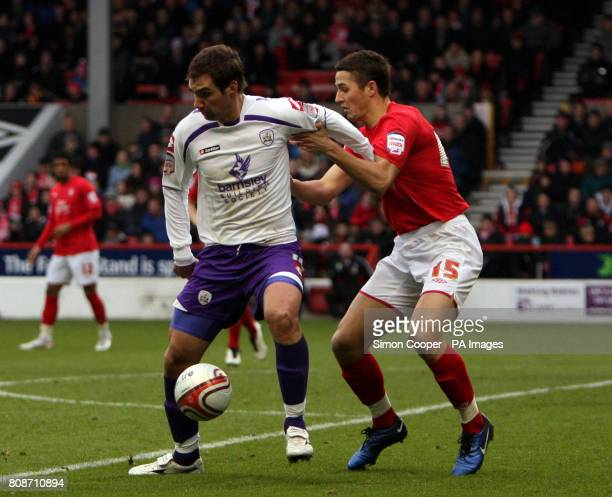 Nottingham Forest's Chris Cohen and Barnsley's Goran Lovre in action during the npower Championship match at the City Ground Nottingham
