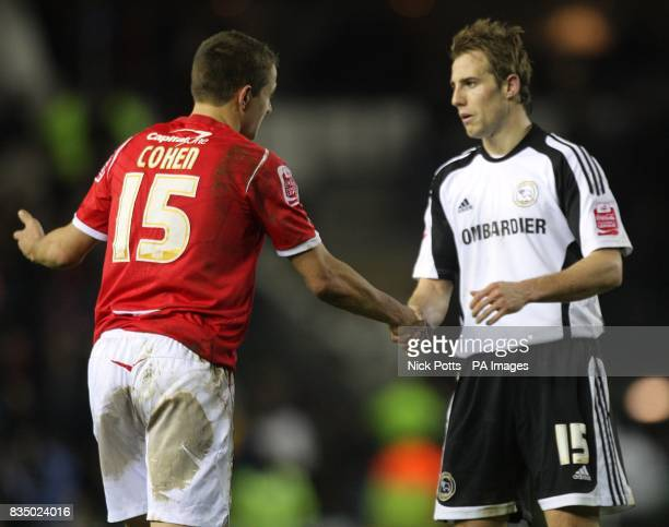 Nottingham Forest's Chris Cohen and Derby County's Luke Varney shake hands after a contentious challenge