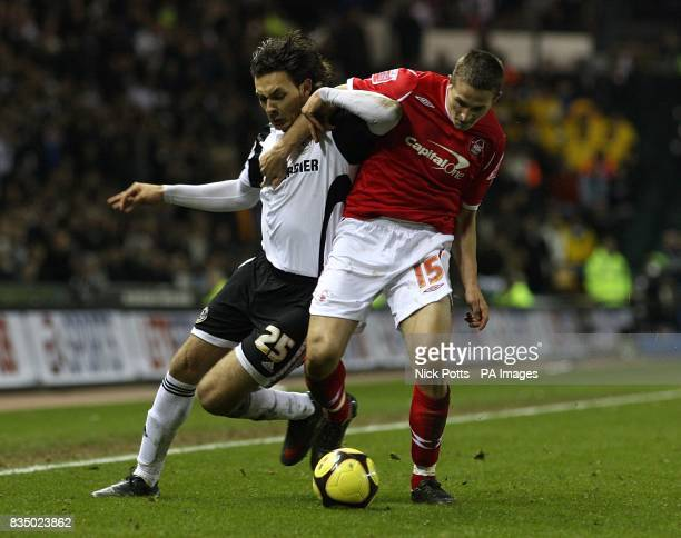 Nottingham Forest's Chris Cohen and Derby County's Nacer Barazite battle for the ball
