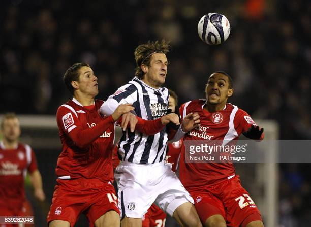 Nottingham Forest's Chris Cohen and Dexter Blackstock battle for the ball with West Bromwich Albion's Jonas Olsson