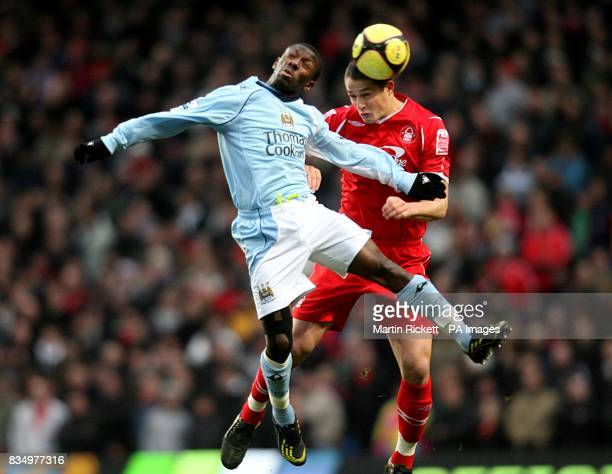 Nottingham Forest's Chris Cohen and Manchester City's Shaun WrightPhillips battle for the ball