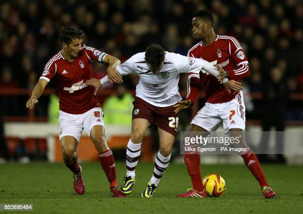 Nottingham Forest's Chris Cohen and Nathaniel Chalobah battle with Burnley's Keith Treacy during the Sky Bet Championship match at The City Ground...