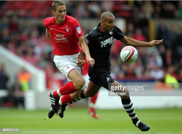 Nottingham Forest's Chris Cohen and Swansea City's Darren Pratley during the npower Championship match at the City Ground Nottingham