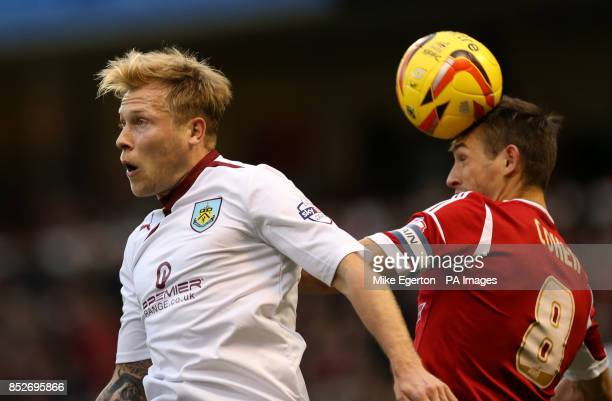 Nottingham Forest's Chris Cohen jumps with Burnley's Scott Arfield during the Sky Bet Championship match at The City Ground Nottingham