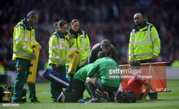 Nottingham Forest's Chris Cohen receives treatment for an injury during the npower Football League Championship match at the City Ground Nottingham