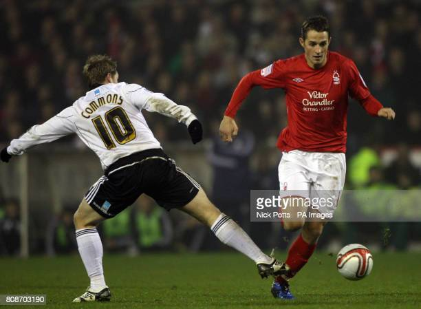 Nottingham Forest's Chris Cohen skips past a challenge from Derby County's Kris Commons during the npower Championship match at the City Ground...