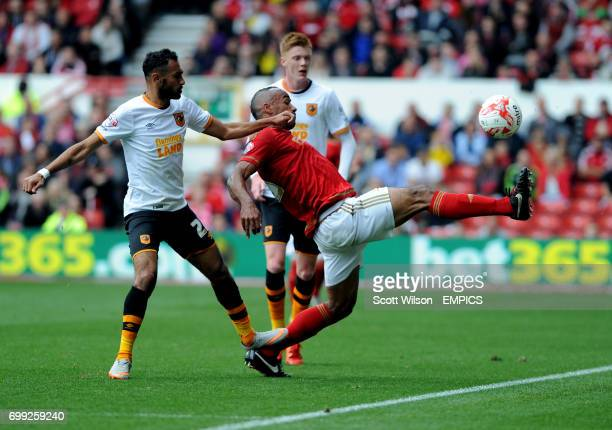 Nottingham Forest's Chris O'Grady and Hull City's Ahmed Elmohamady
