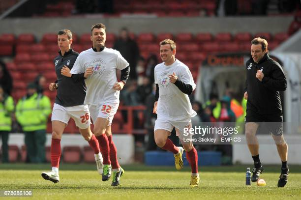 Nottingham Forest's Daniel Ayala Elliott Ward Simon Cox and coach Julian Darby during the warmup
