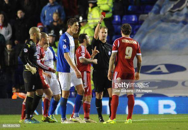 Nottingham Forest's Darius Henderson is shown a red card by referee Robert Madley during the Sky Bet Championship match at St Andrews Birmingham