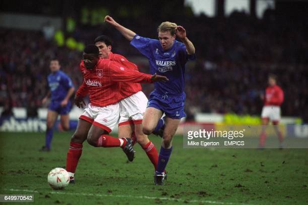 Nottingham Forest's Des Lyttle holds off Leicester City's David Oldfield watched by Nottingham Forest's Steve Chettle