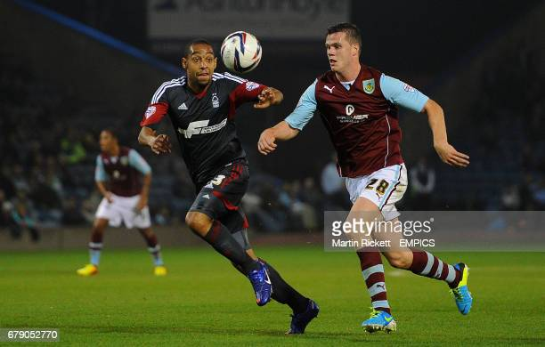 Nottingham Forest's Dexter Blackstock battles for the ball with Burnley's Kevin Long