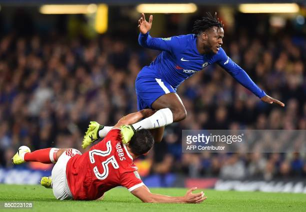 Nottingham Forest's English defender Jack Hobbs vies with Chelsea's Belgian striker Michy Batshuayi during the English League Cup third round...