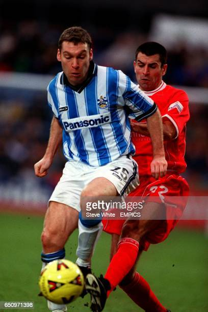 Nottingham Forest's Francis Benali battles with Huddersfield Town's Kevin Gallen