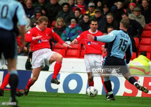 Nottingham Forest's Francis Benali watches on as team mate Tony Vaughan tries to close down Bolton's Kevin Nolan