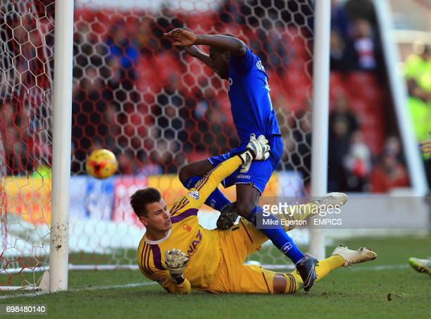 Nottingham Forest's goalkeeper Karl Darlow and Birmingham City's Clayton Donaldson collide as the ball ends up in the net for a goal to David...