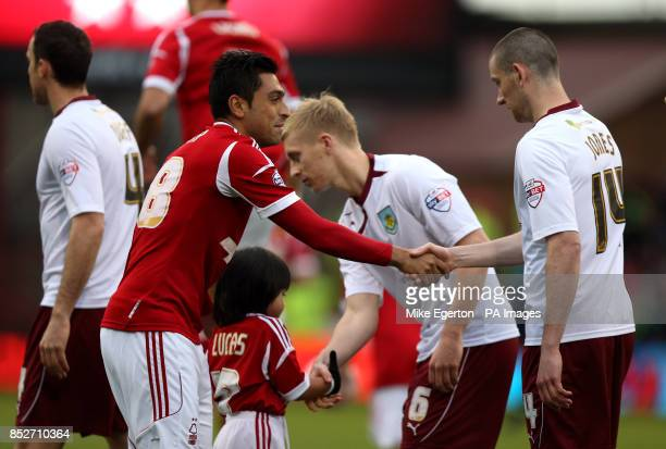 Nottingham Forest's Gonzalo Jara and Burnley's David Jones shake hands before the game