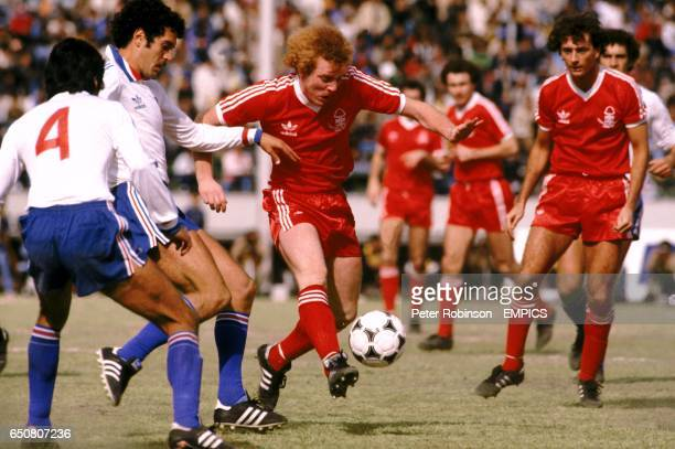 Nottingham Forest's Ian Wallace bursts through the Nacional defence