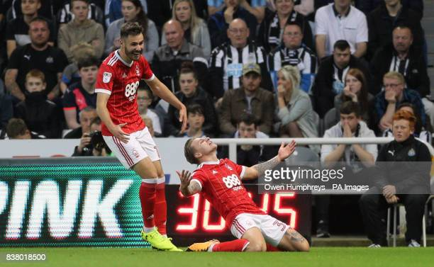 Nottingham Forest's Jason Cummings celebrates scoring his side's second goal of the game during the Carabao Cup Second Round match at St James' Park...