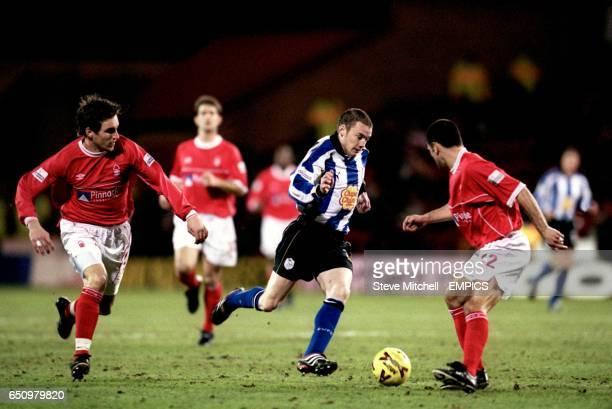 Nottingham Forest's Jim Brennan and Francis Benali close in on Sheffield Wednesday's Alan Quinn