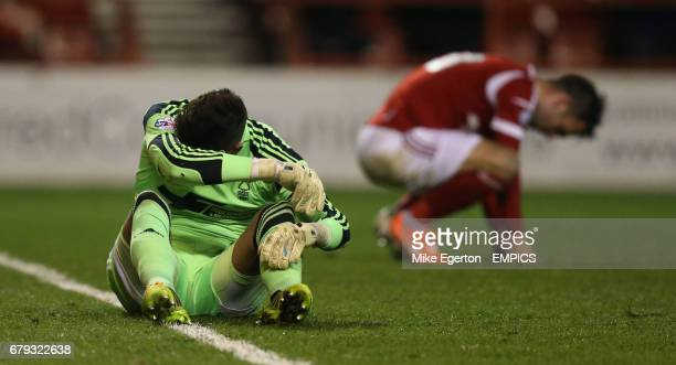 Nottingham Forest's Karl Darlow and Greg Halford sit dejected after the first Charlton goal