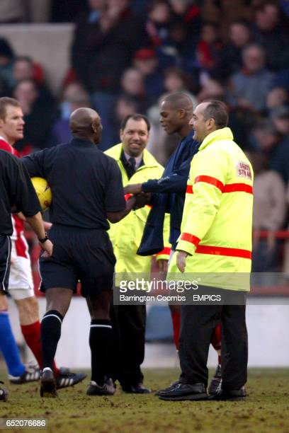 Nottingham Forest's Marlon Harewood seeks the matchball from referee Uriah Rennie who seems reluctant to hand it over after Harewood scored four...