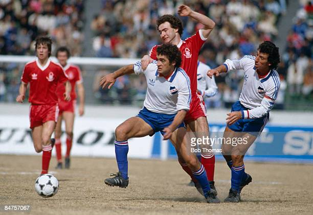 Nottingham Forest's Martin O'Neill battles with Nacional's Denis Milar and Victor Esparrago in midfield during the World Club Championship match in...