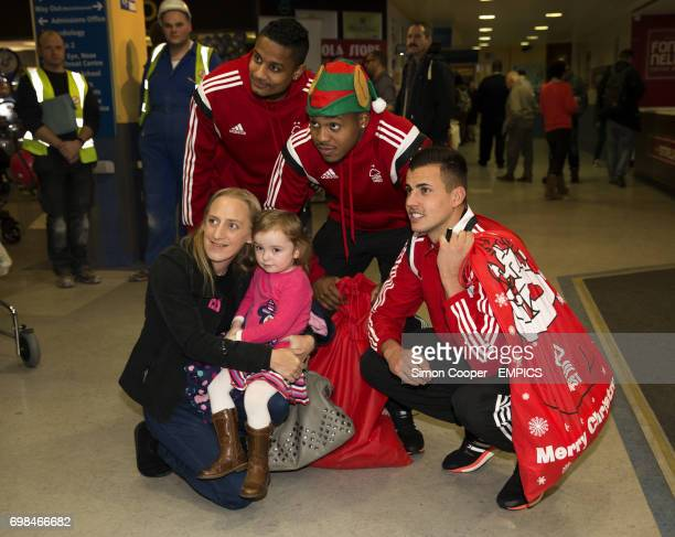 Nottingham Forest's Michael Mancienne Britt Assombalonga and Karl Darlow pose with fans during a hospital visit to Queens Medical Centre